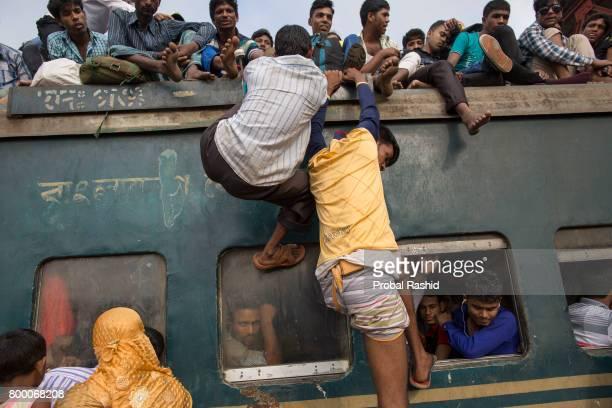 GAZIPUR DHAKA BANGLADESH DHAKA BANGLADESH Bangladeshi people climb onto the roof of an overcrowded train as they travel back to their homes ahead of...