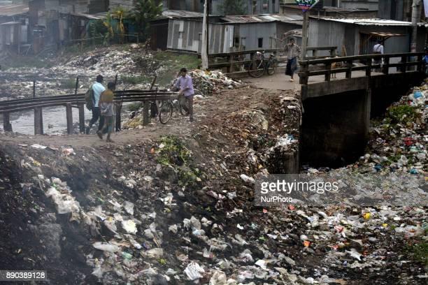 Bangladeshi people crossing a broken concrete bridge near kamrangirchar Dhaka on Monday December 11 2017