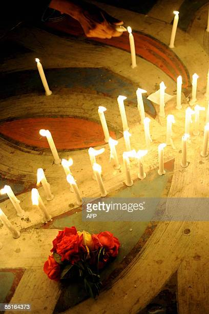 Bangladeshi people light candles during a remembrance gathering for people killed during the recent mutiny at the Bangaldesh Rifles heaquarters in...