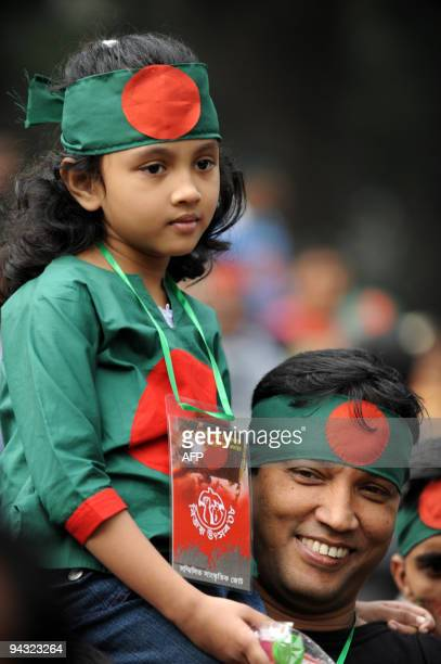 Bangladeshi people look on during a rally held to mark country's 37th Victory Day in Dhaka on December 16 2008 Bangladesh won independence from...