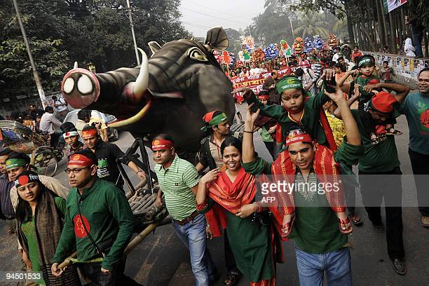 Bangladeshi people march during a rally held to mark the country's 38th Victory Day in Dhaka on December 16 2009 Bangladesh won independence from...