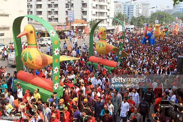 Bangladeshi people participate in a rally to celebrate the first day of the Bengali New Year or Pohela Boishakh in Dhaka, Bangladesh on April 14,...