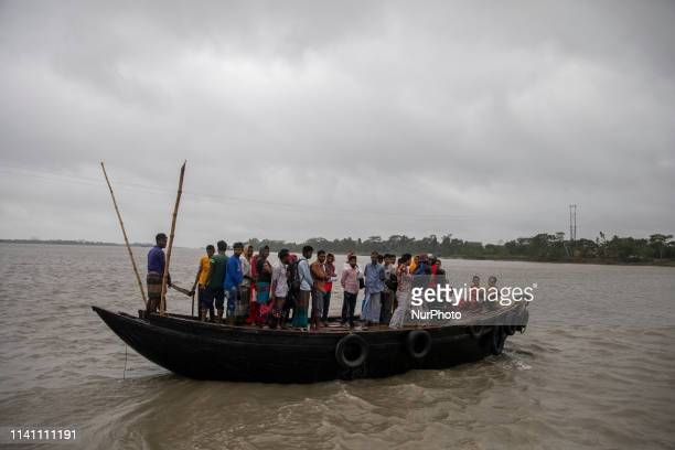 Bangladeshi people returnes home by crossing Jhopjhopia river in Khulna Pan Khali on May 4 as Cyclone Fani reached Bangladesh Cyclone Fani one of the...