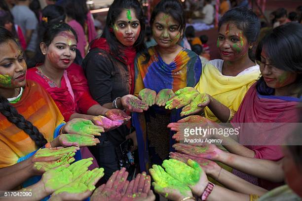Bangladeshi people show their hands as they play with colored powders during Holi celebrations in Dhaka Bangladesh on March 23 2016 Holi is the...