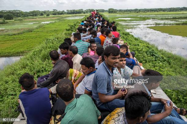 DHAKA BANGLADESH DHAKA BANGLADESH Bangladeshi people travel on the roof of an overcrowded train as they travel back to their village ahead of the Eid...