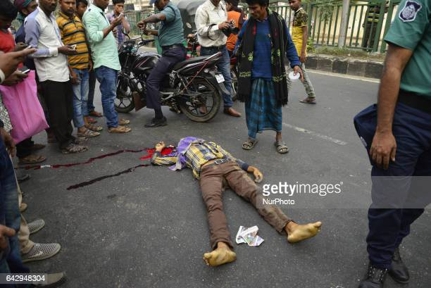 Bangladeshi people watching a dead body at the accident spot at Shahabag in Dhaka Bangladesh On February 19 2017 A man killed by a bus hit on the...