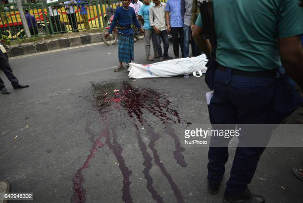 Bangladeshi people watching the site where a dead body at the accident spot at Shahabag in Dhaka Bangladesh On February 19 2017 A man killed by a bus...