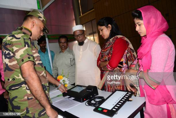 Bangladeshi Peoples visits the Electronic Voting Machine exhibition for watching how to use the Electronic Voting Machine in Dhaka Bangladesh on...