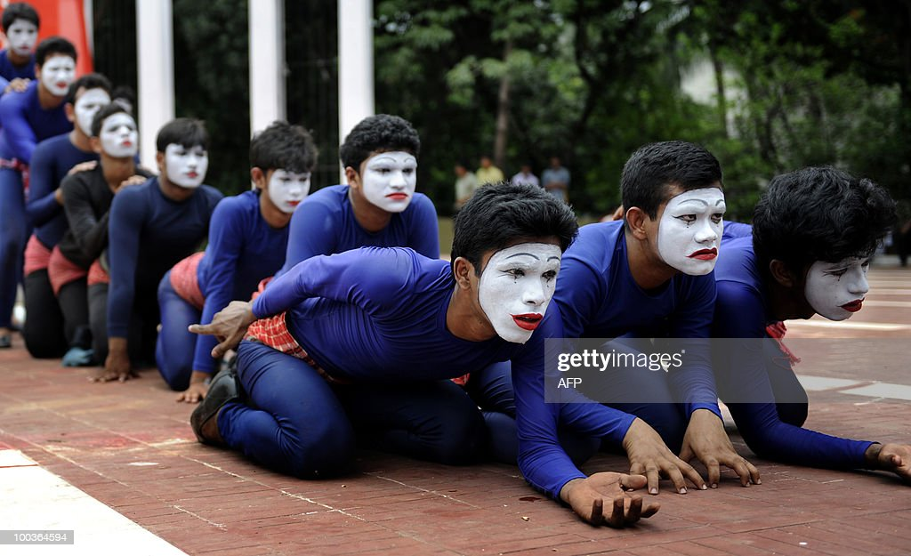 Bangladeshi performers take part in a mime show for the upcoming first anniversary of Cyclone Aila in Dhaka May 24, 2010. Cyclone Aila slammed into southern Bangladesh on May 26, 2009 and while the initial deathtoll was low, less than 300 people were killed , compared to 4000 by cyclone Sidr in 2007 �a huge tidal surge destroyed the network of rivers embankments. A year later the embankments have not been rebuilt, condemning 200,000 people to live in limbo�their land submerged and too salty for crops. AFP PHOTO/Munir uz ZAMAN