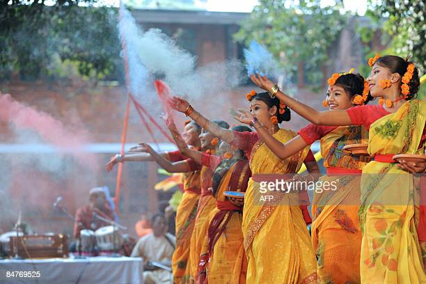Bangladeshi performers throw coloured powder as they dance during the Boshonto Utshob festival in Dhaka on February 13 2009 The spring festival of...