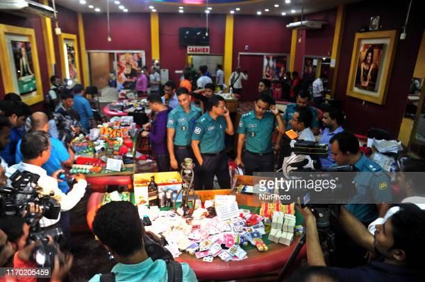 Bangladeshi Police conducting a raid on the Mohammedan Sporting Club, Arambagh Krira Sangha, Dilkusha Sporting Club and Victoria Sporting Club in the...