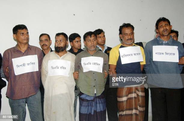 Bangladeshi police display five arrested members of the Bangladesh Rifles for suspected participation in a mutiny in Dhaka on March 3 2009 The...