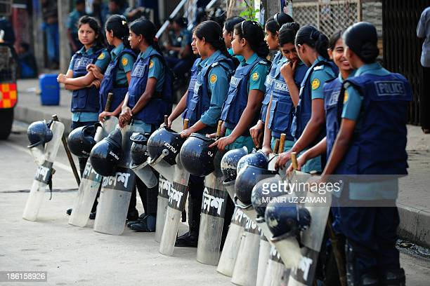 Bangladeshi police officers stand guard during the third day of a nationwide strike called by the opposition Bangladesh Nationalist Party in Dhaka on...