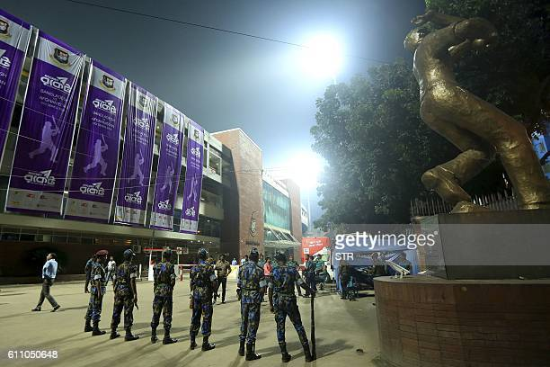 Bangladeshi police officials stand guard during the second One Day International cricket match between Bangladesh and Afghanistan at the...