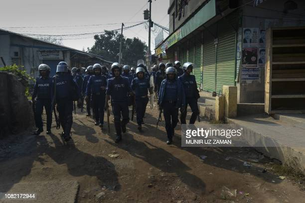 Bangladeshi police patrol near a garment factory in Ashulia on the outskirts of Dhaka on January 14 2019 Bangladesh is dependent on garments stitched...