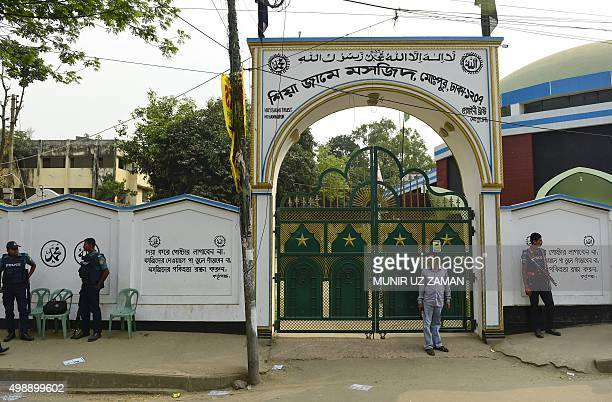 Bangladeshi police personnel stand guard in front of a Shiite mosque in Dhaka on November 27 after authorities increased security following an attack...