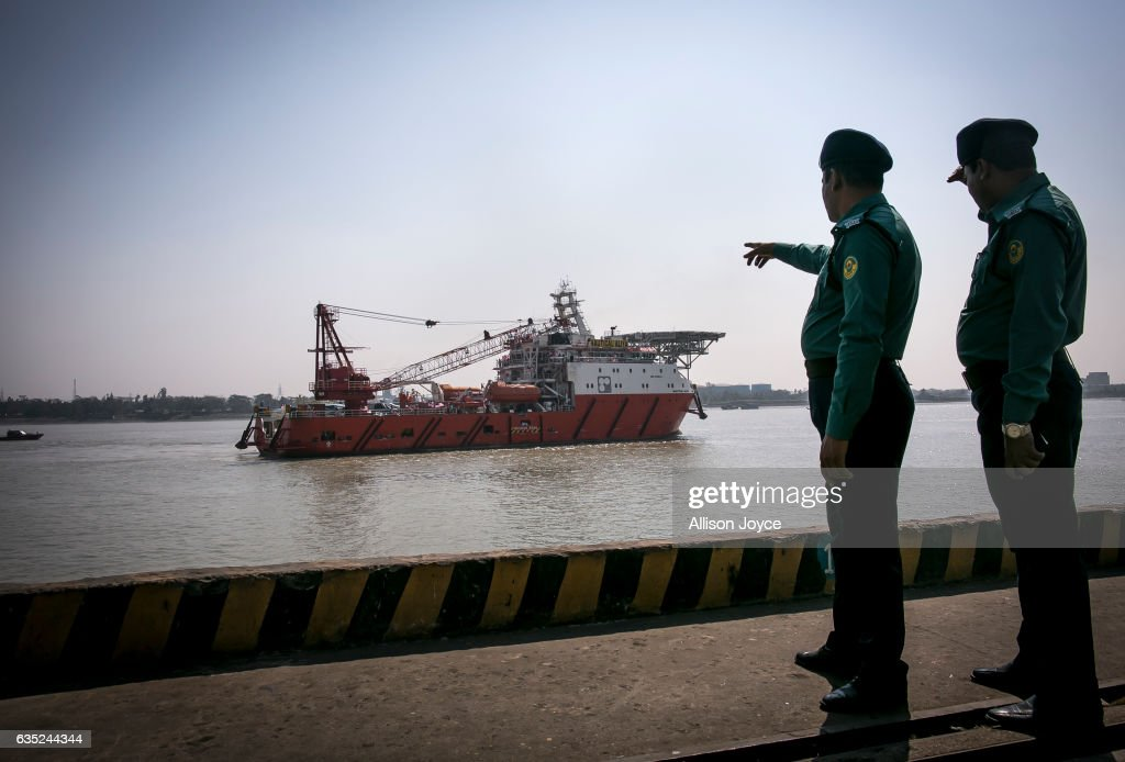 Bangladeshi police point to the Nautical Aliya aid ship on February 14, 2017 in Chittagong, Bangladesh. The Rohingya aid ship, Nautical Aliya, carrying 2,200 tons of rice, emergency supplies and aid-workers, docked at Chittagong Port, about 140km from Cox's Bazar where thousands of Rohingya Muslims take refuge. Around 70,000 Rohingya Muslims have fled to Bangladesh from Myanmar since October last year after the Burmese army launched a campaign it calls 'clearance operations' in response to an attack on border police. According to reports, Bangladesh plans to proceed with a controversial plan to relocate tens of thousands of Rohingya refugees from Myanmar to a remote island in Bay of Bengal, despite warnings it is uninhabitable and prone to flooding. The Rohingya, a mostly stateless Muslim group numbering about 1.1 million, are the majority in Rakhine state and smaller communities in Bangladesh, Thailand and Malaysia.