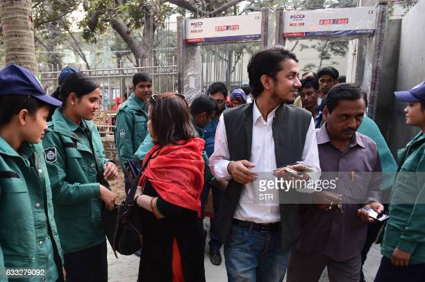 Bangladeshi police search visitors at the entrance to the country's largest bookfair in Dhaka on February 1 2017 Bangladesh's largest book fair began...