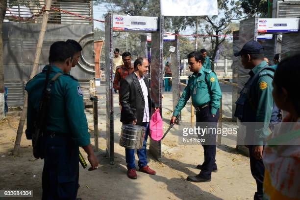 Bangladeshi police search visitors at the entrance to the country's largest book fair in Dhaka on February 03 2017 Bangladesh's largest book fair...