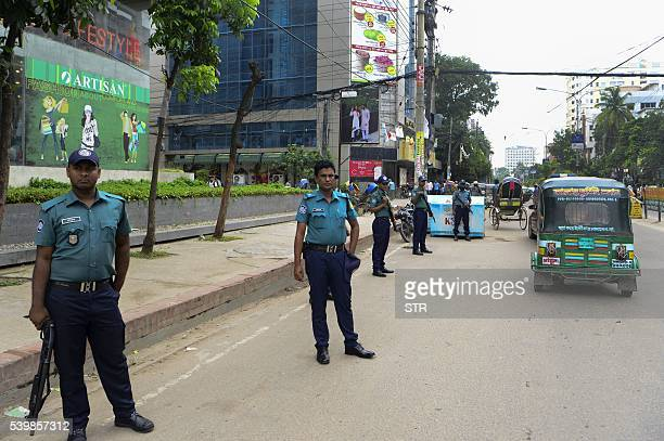 Bangladeshi police stand guard during a nationwide crackdown on militants in Dhaka on June 13 2016 Bangladesh police said June 13 they have arrested...