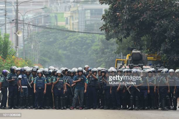 Bangladeshi police stand guard during a student protest in Dhaka on August 5 following the deaths of two college students in a road accident...