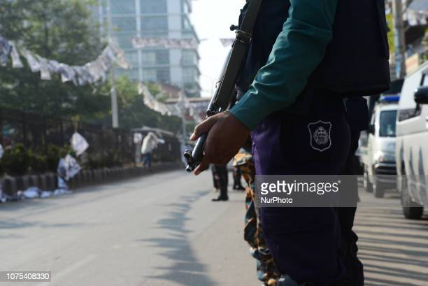 Bangladeshi Police stand guard in a street for the upcoming election in Dhaka Bangladesh on December 28 2018 Election security duties have started to...