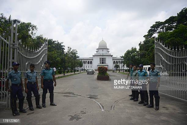 Bangladeshi police stand guard in front of the high court in Dhaka on August 1 2013 Security was tight in the Bangladeshi capital as a top court was...