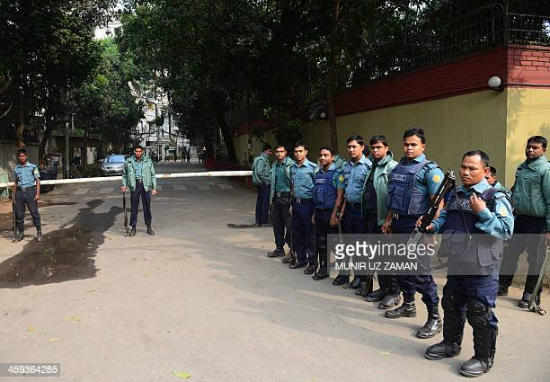 Bangladeshi police stand guard in front of the house of main opposition Bangladesh Nationalist Party Khaleda Zia in Dhaka on December 26 2013...