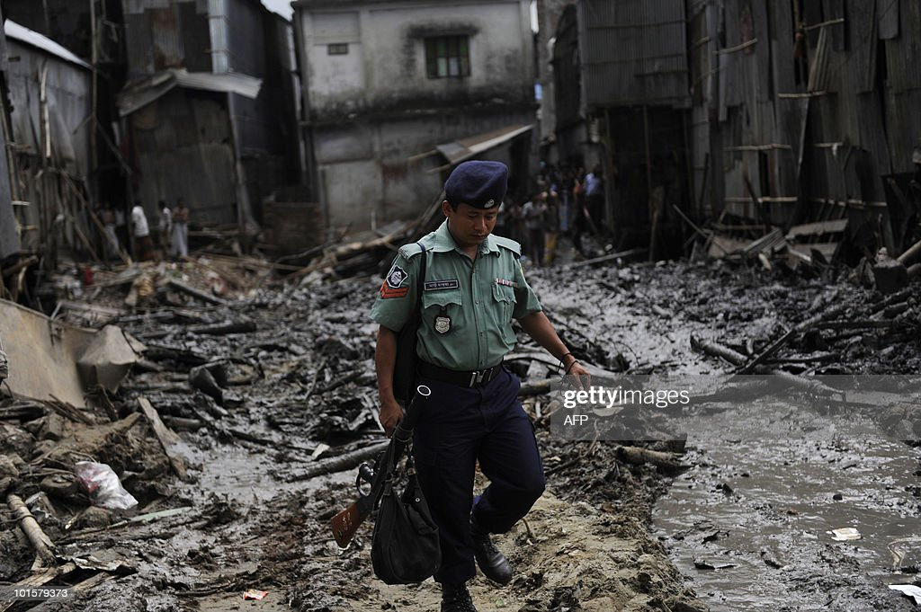 A Bangladeshi policeman walks on the site of a collapsed four-storey building in Dhaka on June 3, 2010. The death toll from the building collapse in the city two days ago rose to 25 on Thursday as the fire service decided to end its rescue operations claiming there were no more missing bodies.