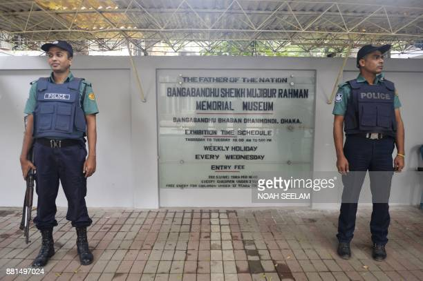 Bangladeshi policemen stand guard at thw Bangabandhu memorial museum ahead of Pope's Francis visit in Dhaka on November 29 2017 Pope Francis schedule...