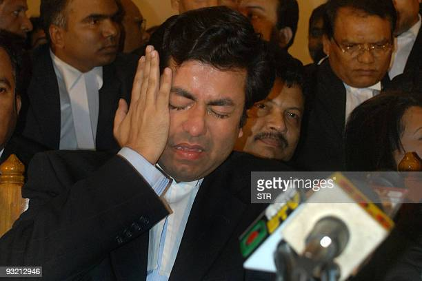 Bangladeshi politician and lawyer, Fazle Noor Tapash cries at a press conference after the verdict for the appeal by five former army officers...