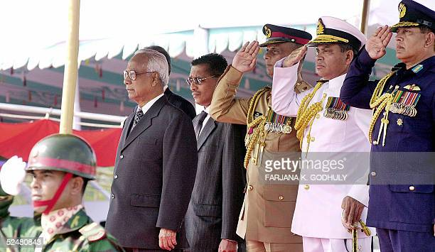 Bangladeshi President Iajuddin Ahmed stands by soldiers' salute among Defence heads during the Independence Day celebrations in Dhaka 26 March 2005...