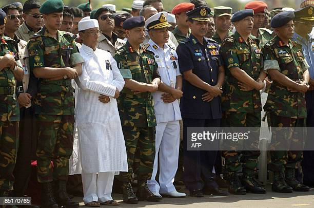 Bangladeshi President Zillur Rahman and Bangladesh Army chief General Moeen U Ahmed perform prayers during a funeral for fallen officers killed...