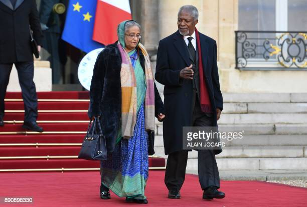 Bangladeshi Prime Minister Sheikh Hasina and Former United Nations secretarygeneral Kofi Annan leave the Elysee palace on December 12 2017 in Paris...