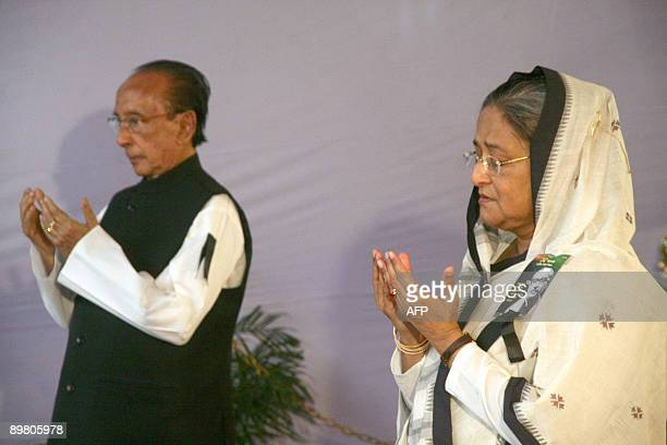 Bangladeshi Prime Minister Sheikh Hasina Wajed offers her prayers after laying a wreath at her father Sheikh Mujibur Rahman's memorial as Bangladeshi...