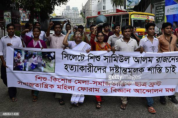 Bangladeshi protesters carry a banner during a demonstration against the lynching of a 13yearold boy in Dhaka on July 14 2015 Outrage over the...
