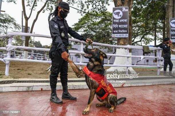 Bangladeshi RAB Dog squad unit seen at the Central Shaheed Minar in Dhaka, Bangladesh. Bangladesh is preparing to celebrate the International Mother...