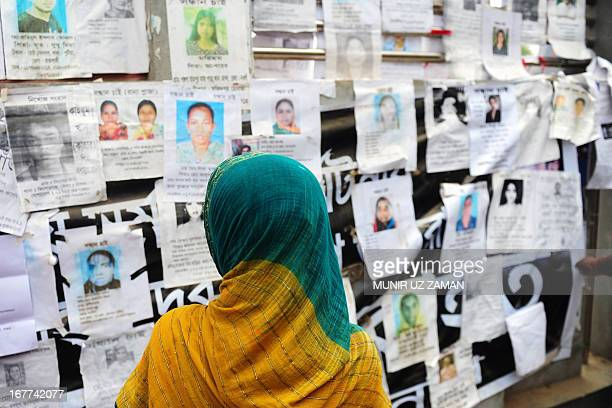A Bangladeshi relative looks at a board posting notices of missing and dead workers of an eightstorey building collapse in Savar on the outskirts of...
