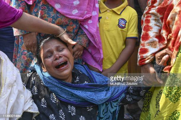 Bangladeshi relative of a victim killed in the Rana Plaza building collapse reacts as she and others mark the sixth anniversary of the disaster at...