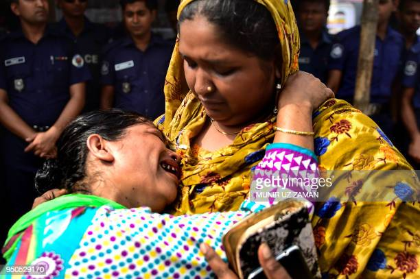 Bangladeshi relative of a victim killed in the Rana Plaza building collapse reacts as she and others mark the fifth anniversary of the disaster at...