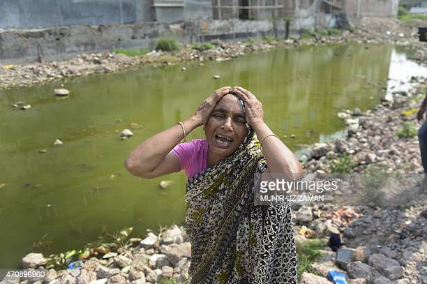 Bangladeshi relative of a victim of the Rana Plaza building collapse weeps as she marks the second anniversary of the disaster at the site where the...