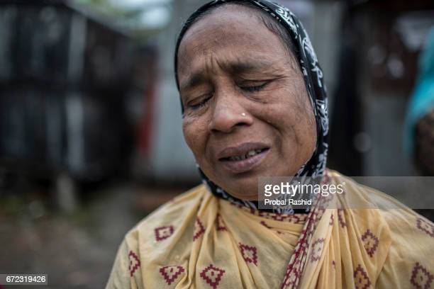 Bangladeshi relative of a victim of the Rana Plaza building collapse weeps as she marks the fourth anniversary of the disaster in Savar, Dhaka on...