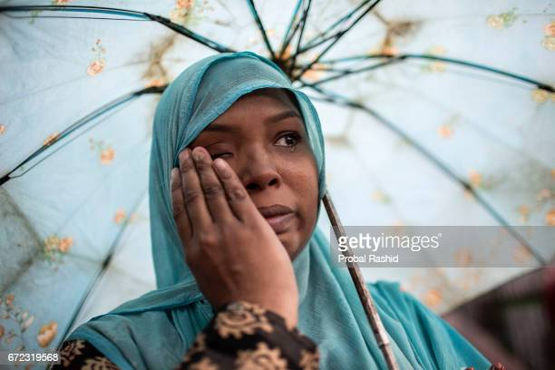 Bangladeshi relative of a victim of the Rana Plaza building collapse weeps as she marks the fourth anniversary of the disaster in Savar Dhaka on...