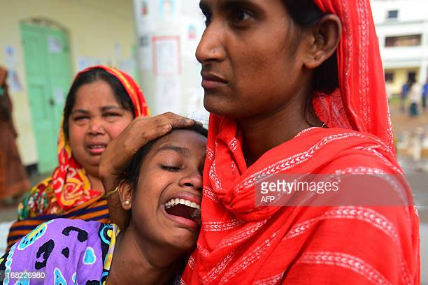 Bangladeshi relative reacts after identifying the body of her father killed in last week's building collapse in Savar, on the outskirts of Dhaka, on...