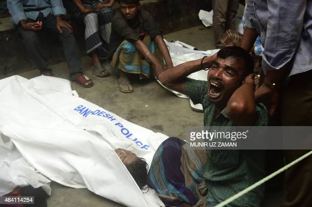 A Bangladeshi relative reacts next to the body of a victim after a ferry accident at Paturia some 70kms east of Dhaka on February 22 2015 Sixteen...