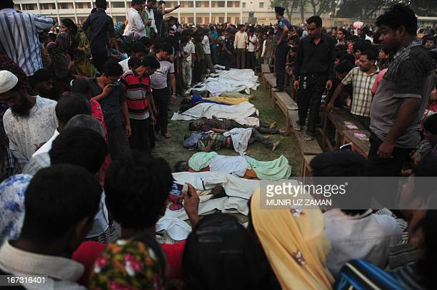 Bangladeshi relatives look at dead bodies after a building collapse in Savar, on the outskirts of Dhaka, on April 24, 2013. An eight-storey building...