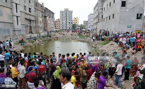 Bangladeshi relatives of victims of Rana Plaza cry as they gather at the spot on the second anniversary of the garment factory building collapse in...