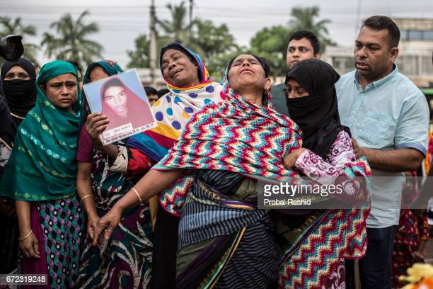 Bangladeshi relatives of victims of the Rana Plaza building collapse weep as they mark the fourth anniversary of the disaster in Savar, Dhaka on...