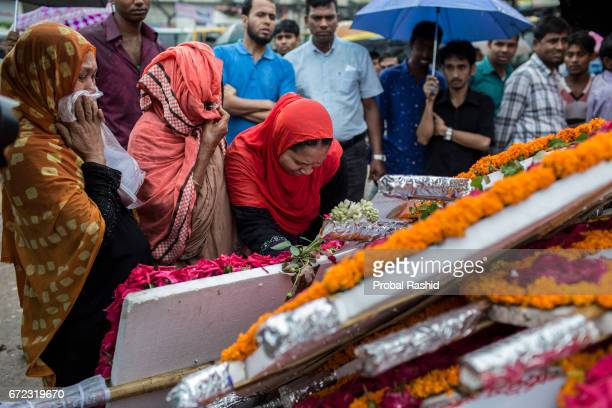 SAVAR DHAKA SAVAR DHAKA BANGLADESH Bangladeshi relatives of victims of the Rana Plaza building collapse offer flowers at the memorial site of the...