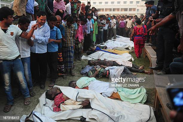 Bangladeshi relatives react next to dead bodies after a building collapse in Savar, on the outskirts of Dhaka, on April 24, 2013. An eight-storey...